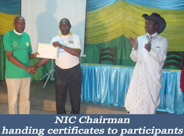 NIC-Chairman-handing-certificates--Looking-on-is-ULK-Gisenyi-Vice-Rector-Academics_-Dr-MUNYAMASOKO-Emmanuel.jpg