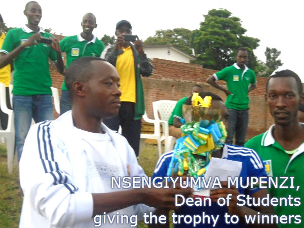 Dean_of_Students_giving_the_trophy_to_winners_ulk_gisenyi_campus_interdeapartment.jpg