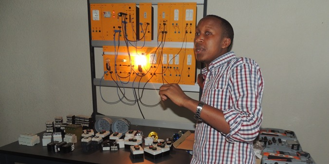 Mr. Innocent NZITONDA explaining to students about the tools used in polytechnic workshops