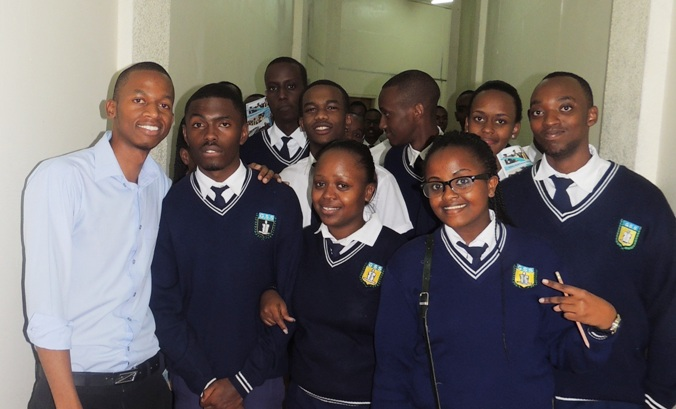 Romalice ISHIMWE, student in Year 3 Computer Science posing with the students